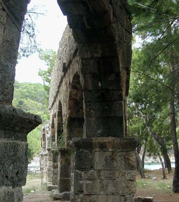 PHASELIS: The most spectacular sight in Phaselis is the last leg of the aqueduct which supplied the city.