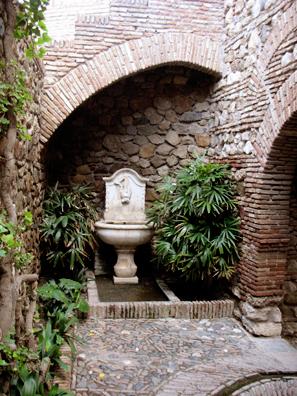 MALAGE: Fountain in a niche.