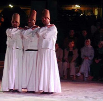 KONYA: At a certain point the dervishes gather in small groups and lean together, reconnecting with each other, before going on to another round of whirling.