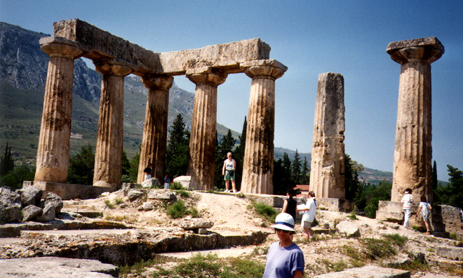CORINTH: The ancient Doric Temple at Corinth, whose stone is deteriorated much more badly than the Parthenon. Its squat form makes a striking contrast with the latter.