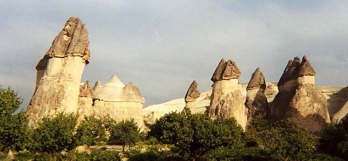 "CAPADOCCIA: The rather phallic-looking ""fairy castles"" near Göreme were formed when the layer of molten lava which solidified on top of the tufa eroded at a slower rate than the underlying ash deposits."