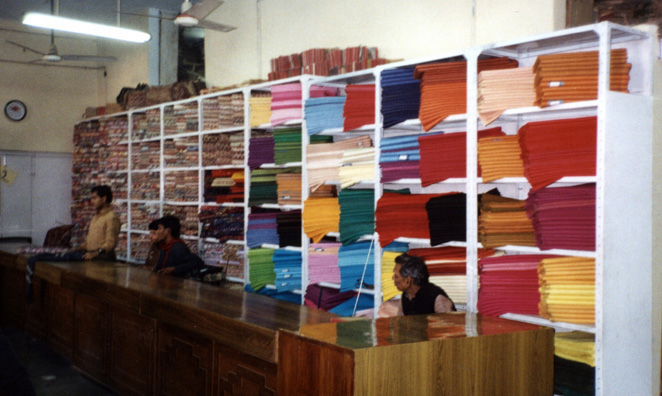 The silk department in the famous khadi emporium on Connaught Circus. Khadi is the rough homespun cloth which Gandhi promoted as an alternative to British woven goods during the struggle for independence. His picture was prominently posted in the shop. These fine silks are a different matter entirely, however.