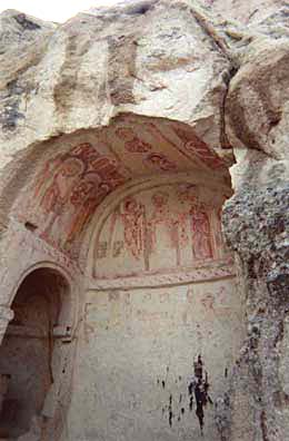 CAPADOCCIA: In some, you'll note that pious Muslim visitors scratched out the eyes of the painted figures so that they no longer violated the proscription against images of living beings.