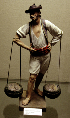 MALAGE: There were numerous souvenir miniatures like these made by local craftsmen, depicting traditional costumes and occupations. This one is a fish street vendor. In Museo de artes y costumbres populares, M‡laga.