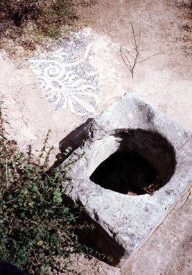 CORINTH: Fragment of a mosaic beside a cistern.