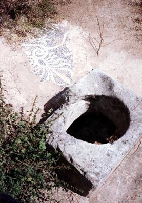 CORINTH: Fragment of a mosaic beside a cistern.