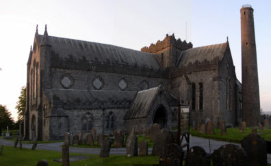 KILKENNY: This composite shot of the 13th-century Protestant St. Canice's Cathedral somewhat distorts the building, but gives a pretty good idea of its layout. The tower beside it may predate the church, having been erected some time between 700 and 1000.