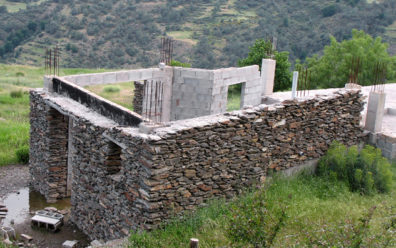 LAS ALPUJARRAS: This unfinished structure shows how modern builders imitate the traditional look of dry stonework by cementing the stones against a poured concrete frame. Unfortunately, the result is a building considerably more vulnerable to the area's frequent earthquakes.