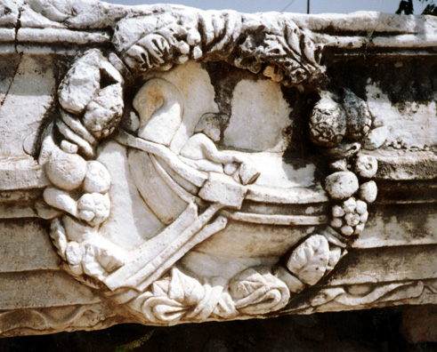 CORINTH: This fanciful Roman era relief depicts someone in a swan-prowed boat within a wreath of food.