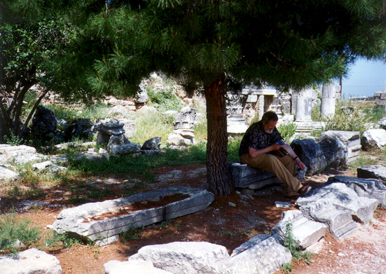 CORINTH:Don Bushaw reading his guidebook outside the Corinth museum.