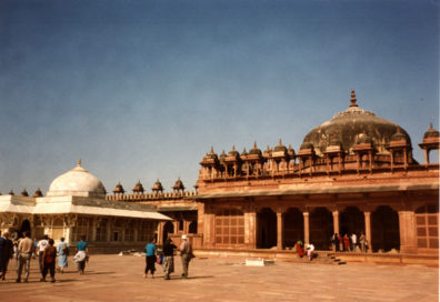 Mausoleum of Sheikh Salim Chishti, built of white marble contrasting with the red sandstone buildings surrounding it. The tomb of this holy man is sought out by women seeking to conceive a child. Fatehpur Sikri was built by the Emperor Akbar as a new capital of the Mughal Empire, but was occupied only from 1570 to 1586.