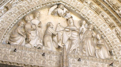 TOLEDO: The tympanum depicts the 7th-century St. Idelfonso (patron saint of Toledo) receiving his chasuble from the Virgin Mary. He was especially noted for his devotion to Mary.