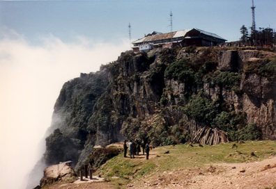 MT. EMEI: Travelers for centuries have reported seeing circular rainbows with their silhouettes enclosed. A rare, but photographable phenomenon (commercial photo). Our own experience of the site was considerably less romantic.