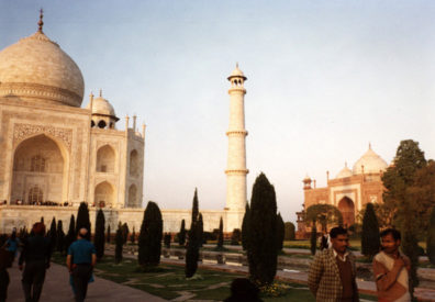 Left, the Taj Mahal, center, a decorative minaret, right: a purely decorative building created as a mirror-image of the mosque to the Taj's left side. The setting sun turns the marble softly golden. 17th C.