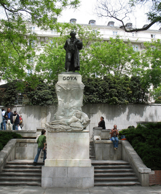 MADRID: Sculpture honoring Spain's most famous painter, Francisco Goya (1746-1828) outside the north entrance of the Prado Museum. At his feet is carved a replica of his famous Maja Desnuda (Naked Maja). Beside him a street musician plays a recorder.