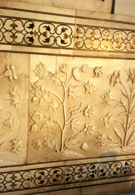Detail of carved floral relief decorations in the marble walls of the Taj Mahal. Above and below, semiprecious stone inlay work. 17th C.