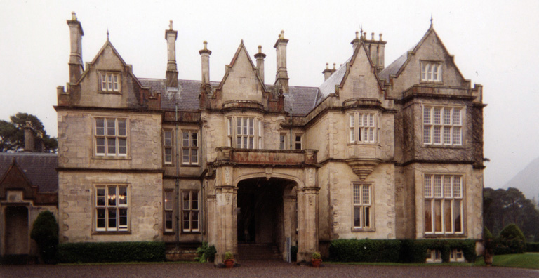 MUCKROSS HOUSE: Kenmare was charming, but drowned under a downpour so heavy we had to give up the idea of driving the Ring of Kerry, and retraced our path across the mountains through the park, stopping to tour Muckross House, a pleasant country estate once visited by Queen Victoria.