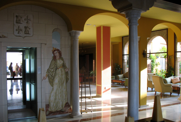 CARMONA: The fancifully painted elevator in the lobby contains a mirror which reflects the entrance. The lady in the painting is, of course, the 15th-century queen alluded to in the hotel's name.