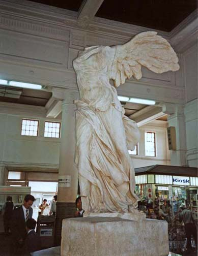KURASHIKI: We took the train to Kurashiki, a picturesque village about an hour's north of Kyoto by Shinkansen. It prides itself on Western art culture. Its claim to fame is its numerous museums. So art-conscious is the town that this full-scale reproduction of the Winged Victory greets passengers in the waiting room of the local train station. May 19, 1998