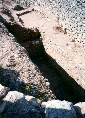 MYCENAE: One of the famous trench tombs in which the treasure of Mycenae was found.