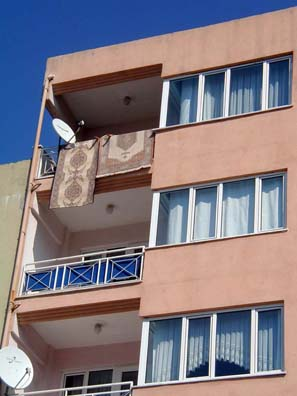 CANAKKALE: Walking around town, we repeatedly saw two objects on the ubiquitous apartment balconies: Turkish carpets and television satellite dishes. Turkey has a large number of satellite systems which serve the role that cable plays in the U.S.