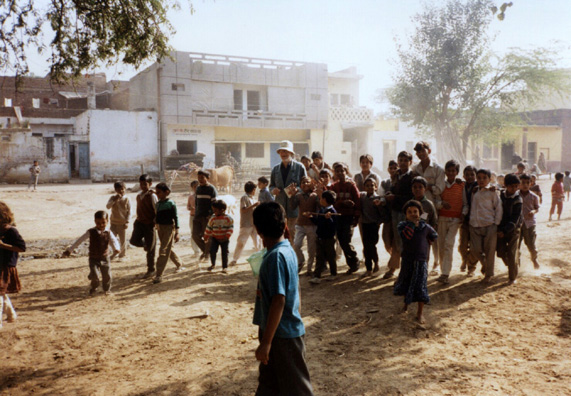 David Thorndike, traveling with the WSU faculty team, charmed the children of this village just outside of Delhi by handing out ballpoint pens as gifts and asking them to sign their name in his notebook.