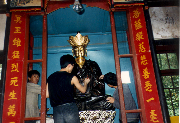 BUDDHIST MONASTERIES: In one quite lovely Buddhist nunnery we saw statues being gilded.