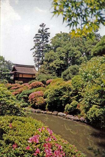 NARA: Mounds of azaleas blossom along this stream in this famous Isui-en Gardens. May 21, 1998
