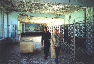 In the same cafe (near our apartment house). Behind me walks Sasha's friend Maksim. It was he who drove us to Pripyat in his car.