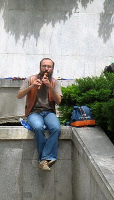 MADRID: A street musician plays Renaissance dance tunes on his recorder outside the entrance to the Prado Museum, Madrid.