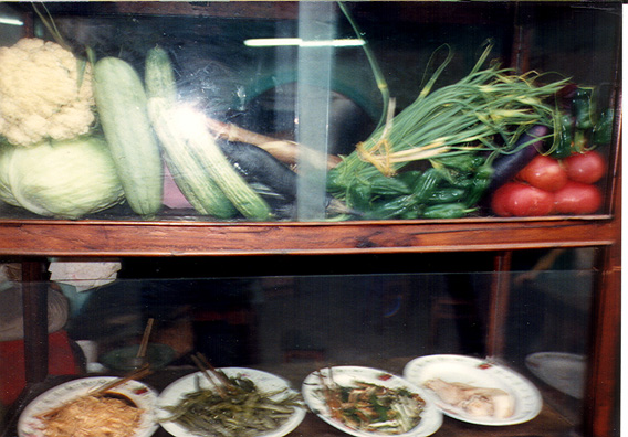 LESHAN: Food on display at a streetside restaurant.