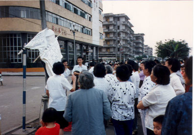 LESHAN: Women (and one man) doing group singing on the street . . .