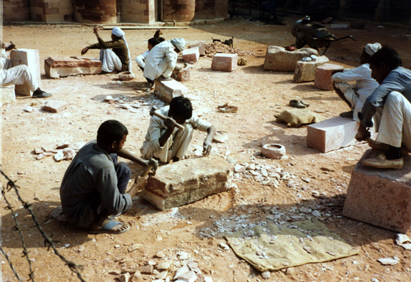 Workers shaping replacement stones to repair the Qutub Minar. The tower was completely rebuilt in the 19th century after it had been destroyed by an earthquake.