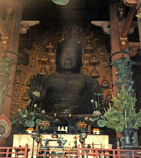 NARA: For centuries this was the largest cast-metal Buddha in the world, made of 437 tons of bronze. The original was even larger, but it was destroyed in an earthquake. To get a sense of scale, note the white dishes holding oranges on the left and right. In the Daibutsu Hall, Todai-ji Temple, Nara. May 21, 1998