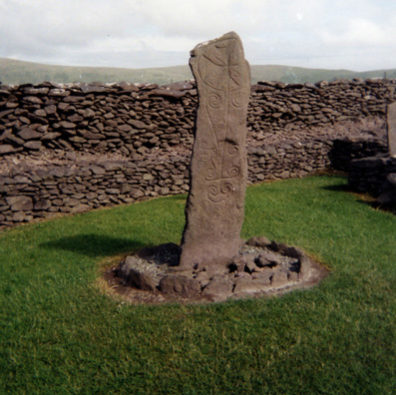 DINGLE PENINSULA: Also at Riasc is this standing stone with Celtic designs on it; note the cross at the top.