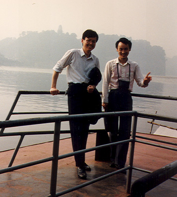 LESHAN: May 19: Mr. Cai and the Russian-speaking guide on the boat on the way to the Big Buddha.