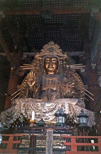 NARA: A smaller image of an incarnation of the Buddha, seated to the left of the famous giant bronze Buddha in the center of the main altar of the Daibutsu Hall. Another such image is on the right side. May 21, 1998
