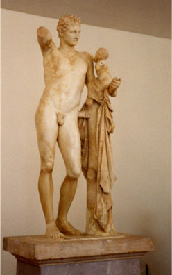 OLYMPIA: The Olympia museum was fascinating. Its most famous sculpture is this Hermes and infant Dionysus.