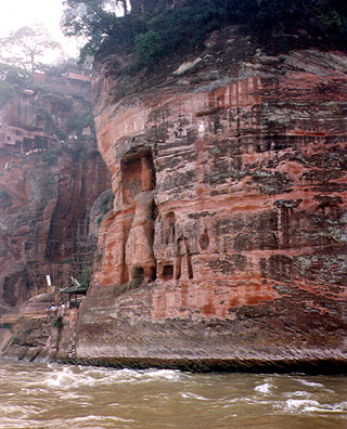 LESHAN: Guardians carved in cliff.