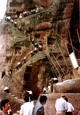 LESHAN: Tourists labor up the winding trail to the top.