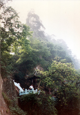 LESHAN: Tourists having lunch on the Buddha's toes.