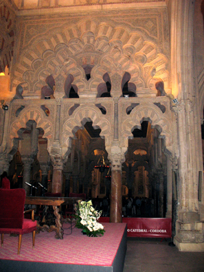 CORDOBA: A wall of more ornately sculpted marble arches.