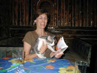 BERGAMA: The restaurant cat looking up the appropriate greeting in Paula's Turkish phrase book.
