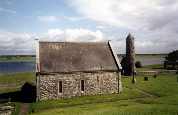 "CLONMACNOISE: The smaller churches on the site are called ""temples."" This is the Temple Finghin and its tower, with the River Shannon running in the background."