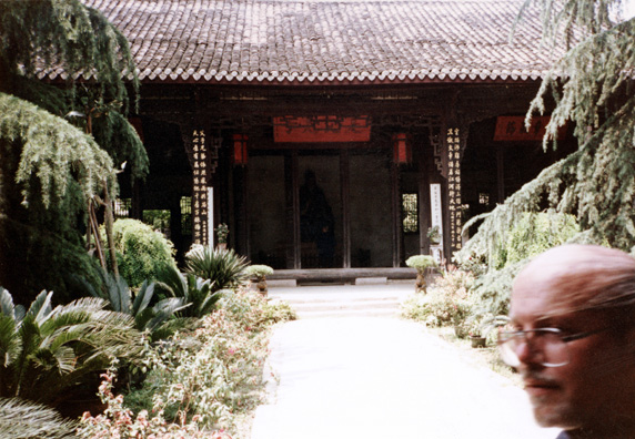 THREE SUS: Temple of the Three Sus near Meishan: shrine to three famous ancient writers, surrounded by beautiful gardens. We could explore only a fraction of them. Terry walked into this shot.