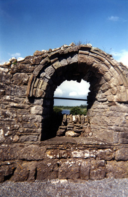 CLONMACNOISE: Arched window from one of the ruined temples at Clonmacnoise.