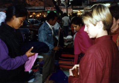 Megan Brians buys a shawl from a street vendor whose features reflect her probable origins in the Himalayas.