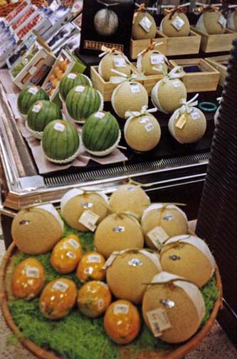 Expensive melons, lavishly presented. Japan is the land of excess packaging. In a bakery, each roll is separately wrapped, then the whole put in a plastic bag. Buy a carton of juice and that gets its own bag too. May 22, 1998