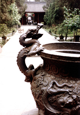 THREE SUS: From the shrine a dragon handle on a pot.