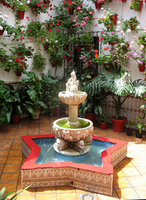 CORDOBA: Note the miniature spitting lions at the base of the fountain, reminiscent of those in the Alhambra.